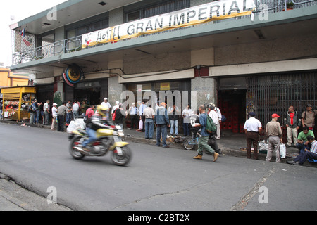 Costa Rica men waiting for a job on a street in San Jose. - Stock Photo