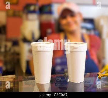 Smiling girl serving drinks over counter San Antonio Texas USA - Stock Photo