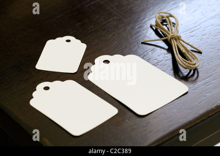 Blank label on wooden table - Stock Photo