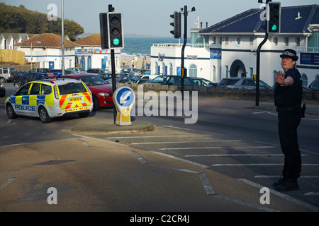 Police woman stopped car due to control traffic due to an incident with at Branksome Chine in April - Stock Photo