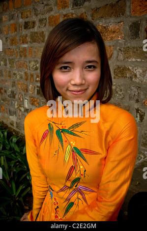 Van Mieu - Quoc Tu Giam, Hanoi, Vietnam - June 2010, Vietnam's girl dressed with the traditional outfit - Stock Photo