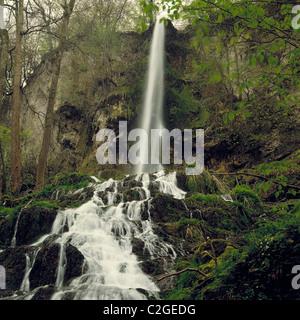 Das Wasser des Bruehlbachs bildet den Uracher Wasserfall im Maisental, Bad Urach, Ermstal, Schwaebische Alb, Baden - Stock Photo