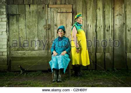 Senior stylish women are dress with a felt clawing. Looking strait to the camera. - Stock Photo