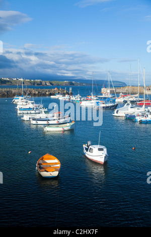 Yachts and fishing boats moored in Portrush Harbour, County Antrim, Northern Ireland. - Stock Photo