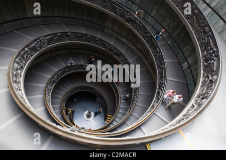 Spiral staircase to the exit in the Vatican Museum, The Vatican, Vatican City, Rome. - Stock Photo