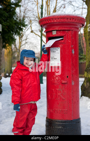 Posting a letter to Santa, England.Post box, Letter box, snow - Stock Photo