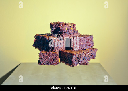 A stack of home made brownies with walnuts - Stock Photo