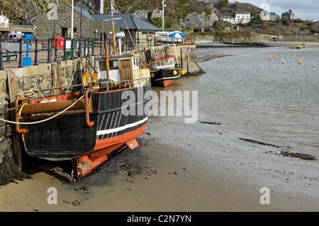 Fishing boats at low tide Barmouth Gwynedd mid Wales UK United Kingdom GB Great Britain - Stock Photo
