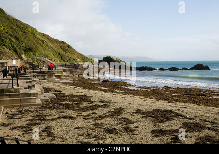 The Cornish sandy beach east of the harbour entrance of Looe in Cornwall. UK. - Stock Photo