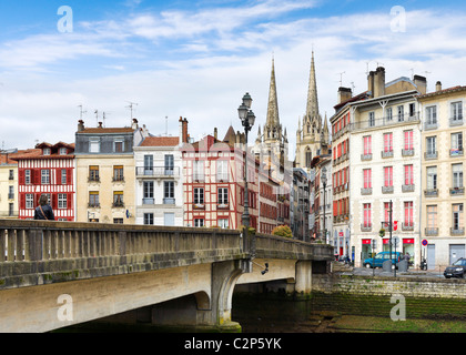 Traditional houses along banks of the River Nive Grand Bayonne with the Cathedral behind, Bayonne (Baiona), Cote - Stock Photo