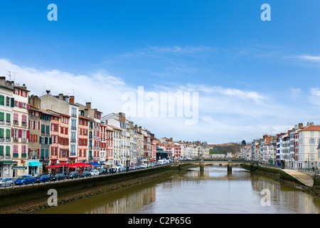 Traditional houses along the banks of the River Nive, Bayonne (Baiona), Cote Basque, Southern France - Stock Photo