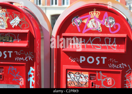 Two red mailboxes smudged all over in Copenhagen,Denmark - Stock Photo
