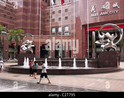 Forecourt fountain at Ngee Ann City shopping centre, Orchard Rd, Singapore - Stock Photo