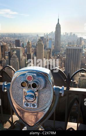 Tourist binoculars overlooking the Manhattan skyline in New York City, USA, United States of America - Stock Photo
