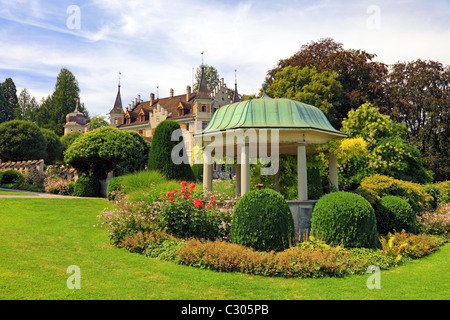 Arbor and flowers near old castle, Switzerland. - Stock Photo