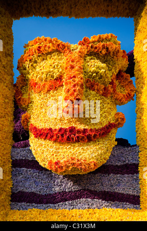 Float in the annual flower parade in Haarlem Holland Netherlands. Colorful mask made of flowers tulips hyacinths - Stock Photo