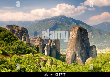 The Roussano Monastery Amongst the Spectacular Meteora Mountains, Meteora, Plain of Thessaly, Greece, Europe - Stock Photo