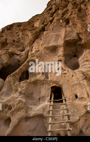 Wooden ladder leading to the Talus Houses, Native American cliff dwelling at Bandelier National Monument in New - Stock Photo