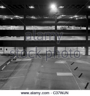 A single car parked in a parking garage at night. New Orleans, Louisiana - Stock Photo