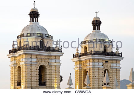 Belltowers of Basilica y Convento de San Francisco de Lima (Saint Francis Monastery) at sunset. Lima, Peru - Stock Photo