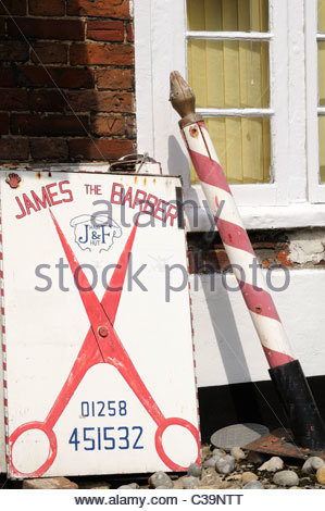 Disused Barbers shop sign and pole, Blandford Forum, Dorset England - Stock Photo