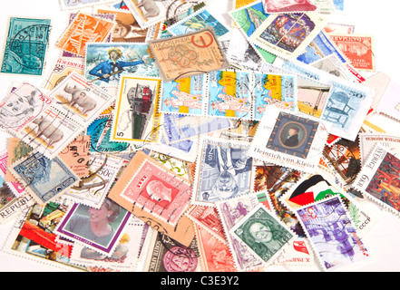 Collection of international postage stamps on a bunch - Stock Photo