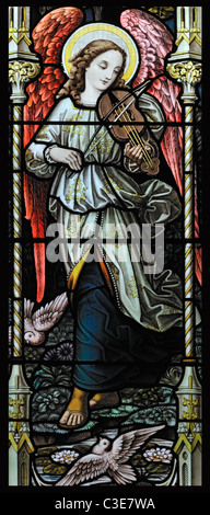 Stained glass window depicting an angel playing a rebec, Booton, Norfolk, England - Stock Photo