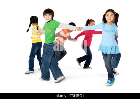 A group of friends playing ring around the rosy game - Stock Photo