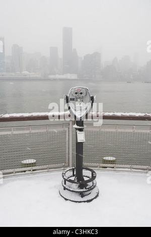 USA, New York City, coin operated binoculars overlooking foggy Manhattan - Stock Photo