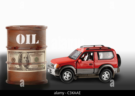 Oil drum with sign of dollar note and  off-road vehicle, close-up - Stock Photo