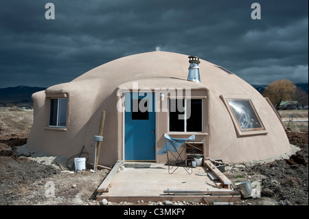 This energy efficient 'monolithic dome' house is made using a vinyl dome and layers of foam. - Stock Photo