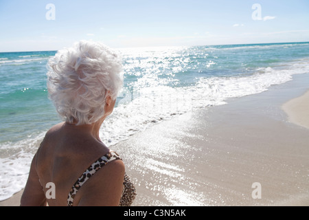 Senior Woman on the beach - Stock Photo