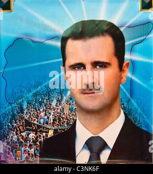 Propaganda Poster of Syrian President Bashar Hafiz Al-Assad - Stock Photo