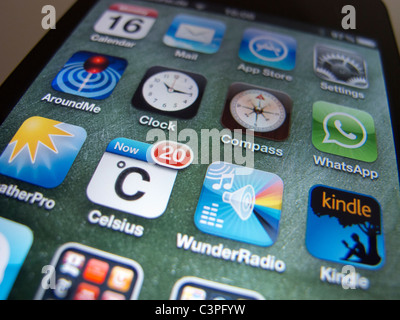 close-up of apps on an Apple iPhone 4G smart phone - Stock Photo