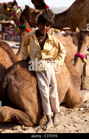 Indian people and daily life during the annual camel fair in Pushkar, Rajasthan, India, Asia - Stock Photo