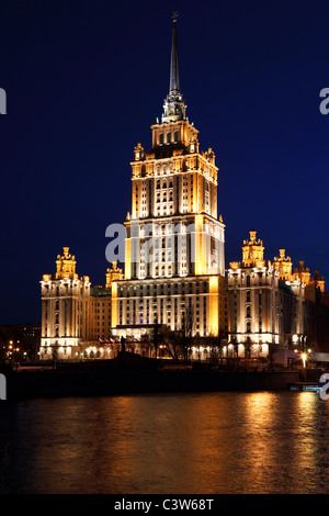 View of High-rise building across Moscow river at night, Moscow, Russia - Stock Photo