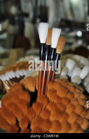 Closeup view of a bundle of Chinese brush pens for calligraphy - Stock Photo