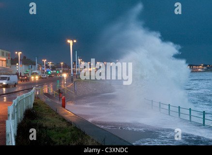 Waves break over sea wall during a gale at Seaburn, Sunderland on the northeast coast of England - Stock Photo