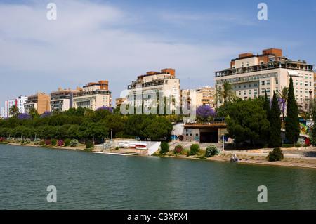 Properties along the banks of The Guadalquivir river. Seville, Spain - Stock Photo