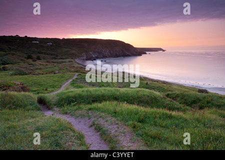 Sunrise on the South West Coast Path at Kennack Sands, Lizard Peninsula, Cornwall, England. Spring (May) 2011. - Stock Photo