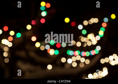 Christmas Lights soft focus. Out of focus christmas lights arrayed on tree branches make a colorful display. - Stock Photo