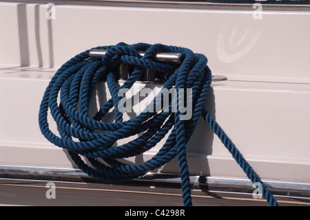 Rope Coiled Round A Boat Cleat - Stock Photo