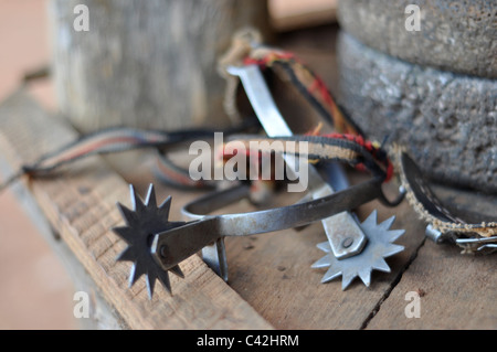 A pair or set of Cuban farmer or cowboy riding spurs, a close-up image shot with a shallow depth of field. Pinar - Stock Photo