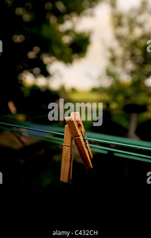 Wooden clothes peg on a washing line. - Stock Photo