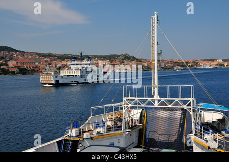 Ferries to and from Palau to La Maddalena (in view), Sardinia, Italy - Stock Photo