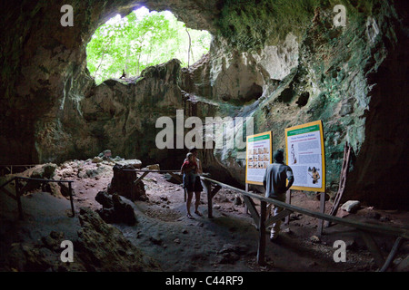 Tourists inside San Gabriel Limestone Cave, Los Haitises National Park, Dominican Republic - Stock Photo