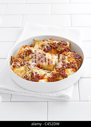 Enchiladas in a round dish, close-up - Stock Photo