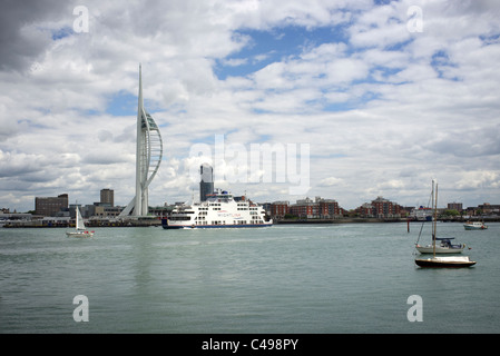 the Isle of Wight ferry entering port in Portsmouth harbour by the Spinnaker tower and the lipstick building - Stock Photo