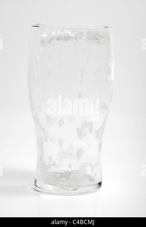 empty pint beer glass isolated on a white gray background - Stock Photo