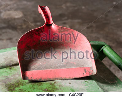tool aged plastic dirty dustpan red object outsid - Stock Photo